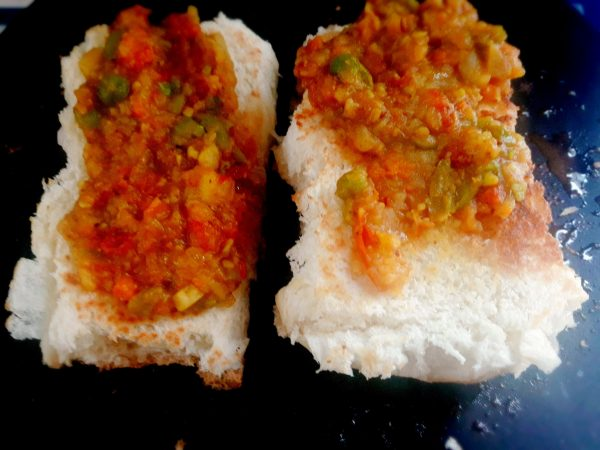 2.Open the Pav and smear the masala evenly with a spoon or spatula. Repeat with the rest of the pav.Masala Pav is ready to be served.
