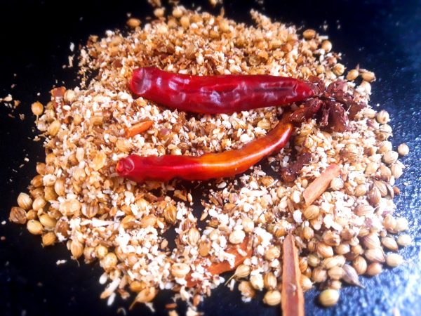 Firstly, on a tawa dry roast all the spices for masala on low flame for 2 minutes. Blend to a fine powder and your Kolhapuri masala is ready. Keep aside.