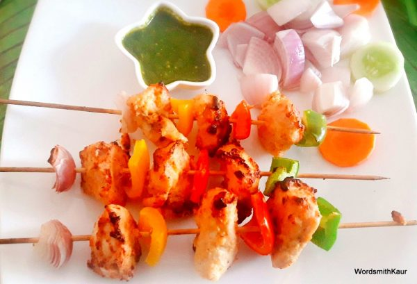 Serve the kebab with mint chutney, onion and lemon wedges