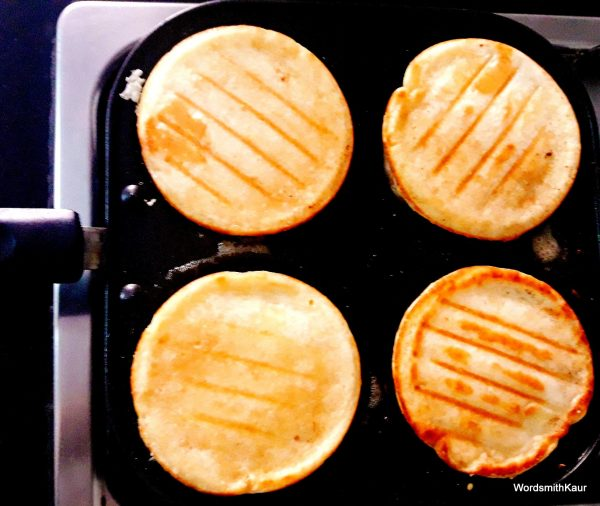 Cook on one side and flip them over. I love this pan I bought recently. It is great for uttapams, pancakes and even omelettes.