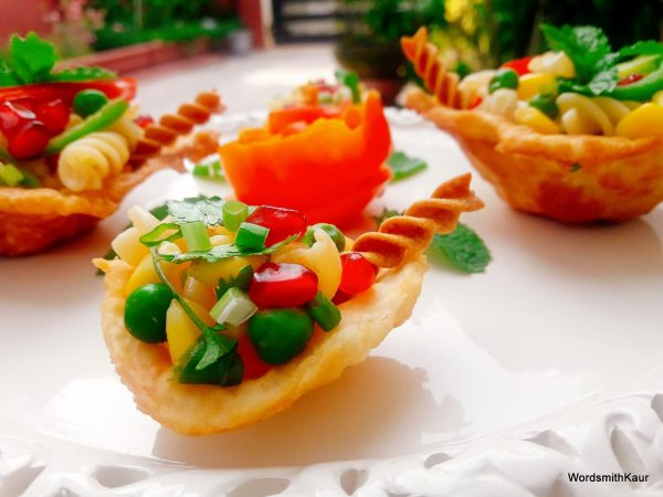 Enjoy yummy Crispy Edible Diyas filled with Pasta Chat.