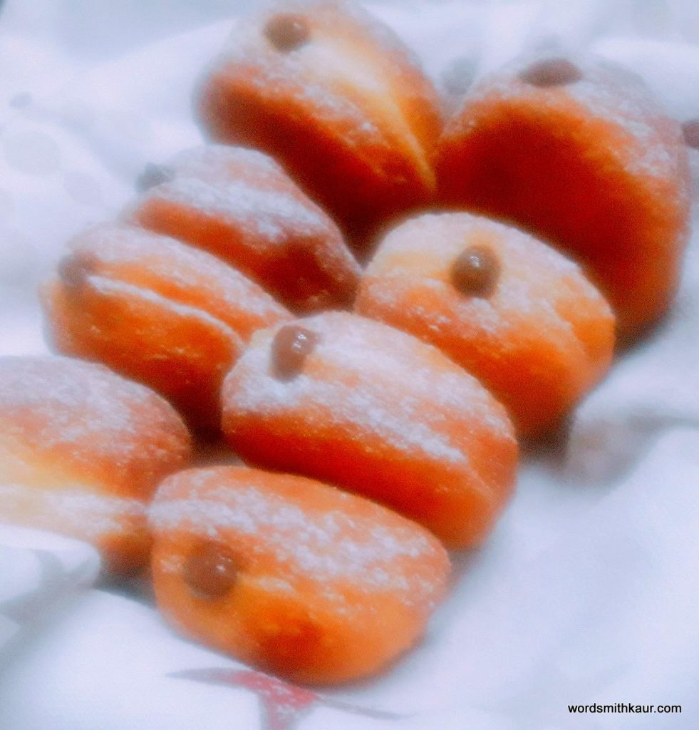 Homemade Mini-doughnuts stuffed with Strawberry Compote and Chocolate custard.
