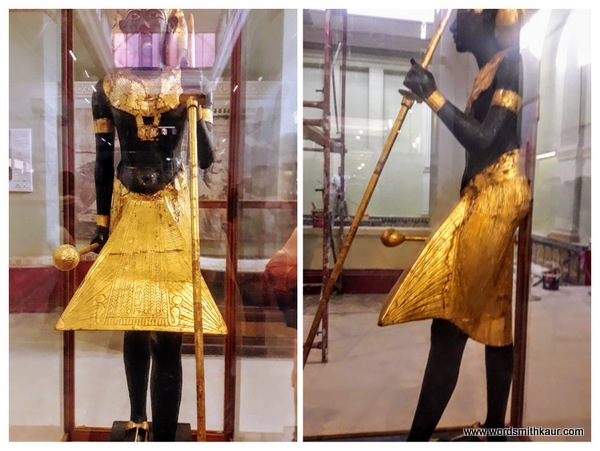 Tutankhamun's statue in Gold  in Cairo Museum. Holding a staff and a mace in each hand.