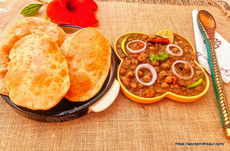 Chole-Bhature Without Garlic and Onion wherein Chickpeas or Chole are soaked overnight and boiled in a pressure and tempered with spices