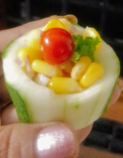Elegant corn salad in cucumber boats