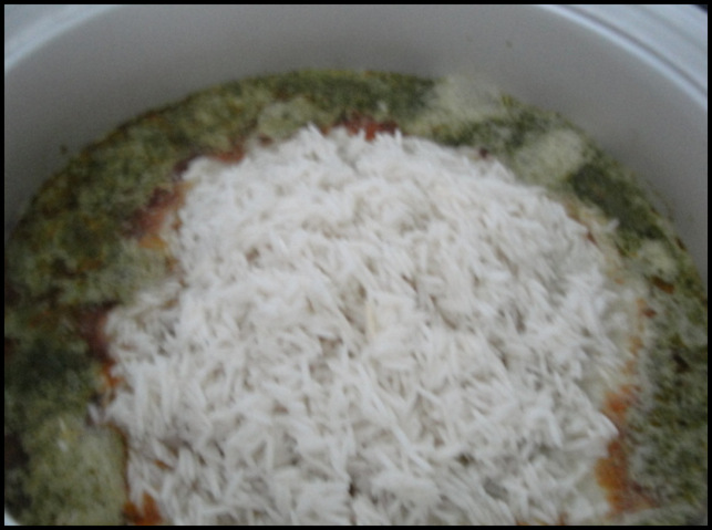 Chicken Dum Biryani with Coconut Milk being cooked